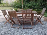Solid teak patio table, 6 x chairs and umbrella