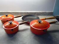 Orange Le creuset pan set, used but good condition.