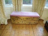 Ottoman with two storage sections and padded top