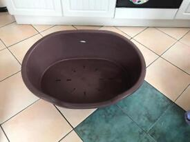 Dog bed and puppy training aids
