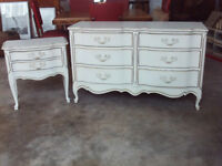 A six drawer chest of drawers an a two drawer bedside cupboard in cream and gold with metal handles