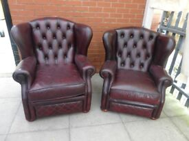 A Pair Of Oxblood Red Leather Chesterfield Chairs