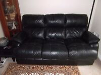 Black leather 3 seater sofa in excellent condition - no cuts or scratches