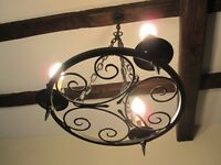 Wrought iron chandeliars ,a matching pair.