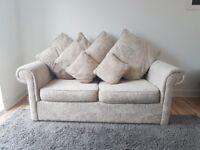 Cream fabric sofa/double bed.