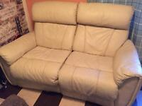 Cream leather electric recliner.
