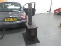 wood burning fire cast iron vermont castings 2ft by 1 ft in size £120 and all in good condition