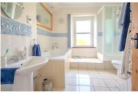 Bathroom Suite, bath shower, sink and toilet
