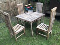 WOODEN TABLE WITH FOUR HIGH BACK CHAIRS