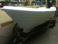 15 and halt foot fiberglass boat on snipe trailer