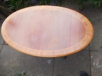 Oval wooden coffee table on pedestal