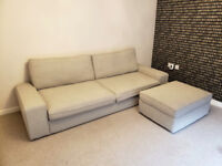 Fabric sofa with pull out sofa bed + storage ottoman.