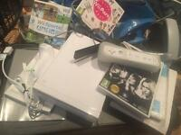 Wii with fitness board remote control, controller, games, instructions in great condition