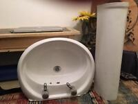 White bathroom pedestal sink