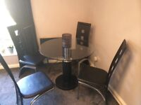 Glass and marble dining table and 4 chairs