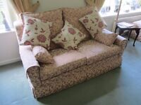 Two seater sofa two armchairs and pouffe