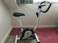 Brand New White Exercise Bike from Coopers of Stortford. Instruction manual included.