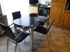 Extending Black glass and chrome table and 4 matching chairs