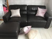 Dark brown leather sofas and footstool