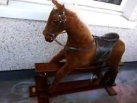 Silver cross rocking horse