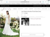 Justin Alexander lace sabrina neckline fit and flare wedding dress
