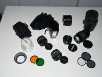 Olympus OM set (lenses 28mm + 50mm + 135mm + tele converter + flash unit + filters + bag)
