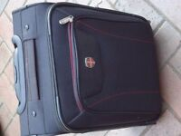 Two new cabin suitcases - black with wheels.