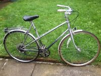 "Raleigh women's bike 27"" wheels,5 gears,front and back mudguards,back pannier carrier,standing leg"