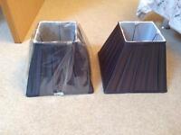Two dark grey lamp shades