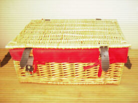 medium light brown red lined wicker hamper picnic basket with straps