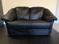 Small black two seater leather sofa