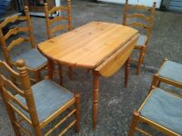 Pine drop-leaf dining table with 6 chairs