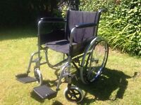Invacare folding wheelchair easy for transporting in car like new.