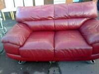Deep red leather settees