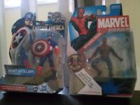 Two boxed collectable figures