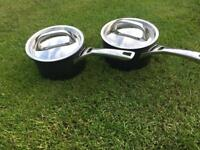 Two 16cm circulon saucepans with lids