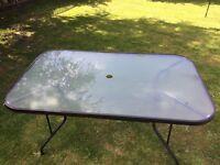 "55"" x 33"" glass top metal frame garden table"