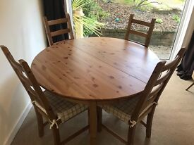 IKEA extendable dining table and 4 chairs with cushions, excellent condition