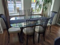 Glass and black dining table and 6 chairs
