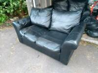 FREE 2 black two seater real leather sofas