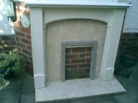 Fire surround, white wood with marbel back and hearth.