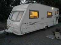 2006 Avondale Dart SE 556-6, 6 berth caravan with awning and starter kit.