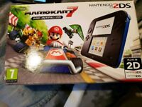 Boxed Nintendo 2DS console + Mario Kart 7 game