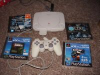 PLAYSTATION 1 SLIM WITH 4 BOXED GAMES