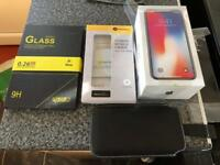 Iphone x 64gb factory unlocked in grey £50 worth of accessories.
