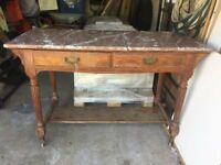sideboard unit, wooden antique marble topped, 2 drawers open shelf below, on brass wheels.