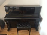HARDLY USED BLACK UPRIGHT YAMAHA PIANO!!! Mint condition as not been used very much.