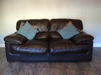 Reids brown leather 3 & 2 seater sofas. Imaculate condition. Pet and smoke free home