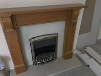 Electric coal effect fire with marble insets and base and oak mantle piece and surround in gd con
