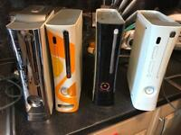 4 Xbox 360s with accessories